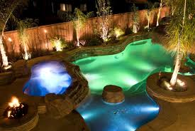 incredible pool lighting in diffe colors transforms this pool into a fun nighttime playground