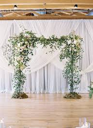 wedding backdrop arch this for an indoor ceremony chris isham photography