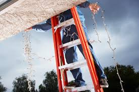 people who hang christmas lights ladder safety how to avoid falls and injuries