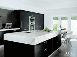 black kitchen cabinets with marble countertops 16 kitchens with marble countertops that wow luxe