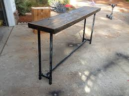 galvanized pipe table legs sofa table with wood washed ashore from the last hurricane
