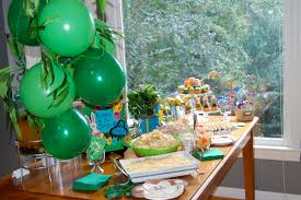safari decorations for home and theme party also cake for birthday exterior safari decorations displayed on a wooden table with a lot of it equipment as