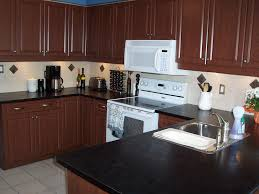 decor brown kitchen cabinets with range hoods and black granite