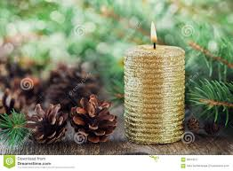 christmas decorations with lighted candle pine cones and fir