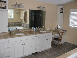 cream granite countertops and grey tile backsplash connected by