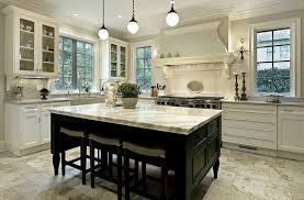 white kitchen with large island kitchen and decor