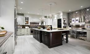 white kitchen cabinets with dark hardwood floors wood floors