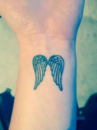 wings wrist small wing tattoos