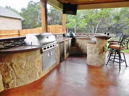 curved outdoor kitchen in austin this well equipped kitchen is