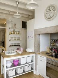 brown wooden island with open shelves kitchen cabinets full size kitchen small island with shelves white pendant lights brown wooden countertop