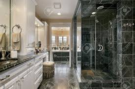 master bath in luxury home with black glass shower stock photo master bath in luxury home with black glass shower stock photo 6733479