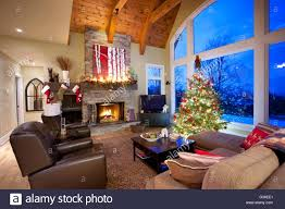 christmas tree in living room with fireplace north america