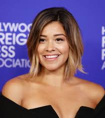 recent tv ads featuring asymmetrical female hairstyles gina rodriguez on her new haircut and jane the virgin