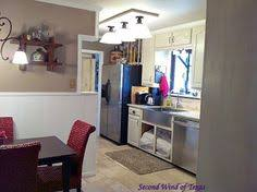 Fluorescent Kitchen Lights by We Replaced The Old Fluorescent Light In Our Kitchen By Covering