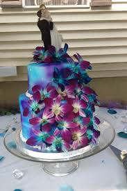 blue and purple wedding wedding cake two circle tiers bright blue and purple color mix
