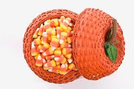 pumpkin candy corn candy corn in pumpkin basket stock photo image 44460860