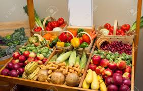 large harvest of fruits and vegetables with a blank sign stock