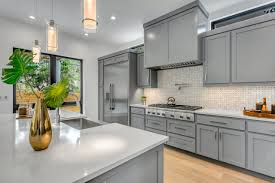 grey kitchen cabinets and black countertops gray cabinetry the new neutral and trend in