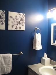 blue bathroom dark blue bathroom and i like the canvas paintings on the wall a lot
