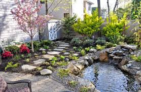 exterior design small backyard pond with cedar fence and stone
