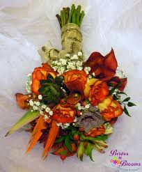 Wedding Flowers Fall Colors - fall color bouquet with succulents bird of paradise roses mini