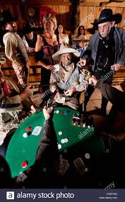 an western cowboy is at cards by the entire