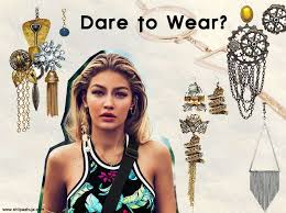 mismatched earrings trend how to wear the single earring trend fall winter 2015