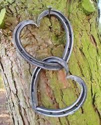 entwined heart shaped horseshoes unicorn shoes
