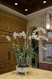 faux orchids decorating with faux floral arrangements