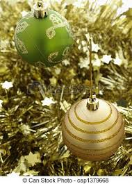 green and gold decorations baubles and tinsel for