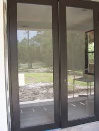 french doors windows wood swinging patio doors chestnut bronze transoms low e glass