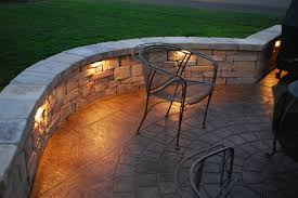retaining wall lights under cap nice lights against similar wall structure than we were thinking