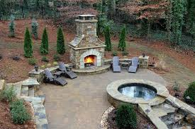 Stacked Stone Outdoor Fireplace - outdoor stone fireplaces inspiration for a large contemporary