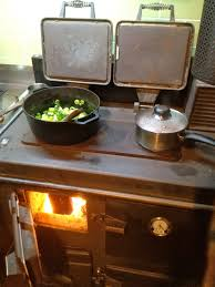 cooking on a rayburn woodstove help us milkwood permaculture