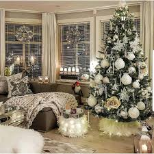 white themed tree and decor large ornaments make such a