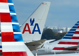 american airlines suspends flight attendant accused of hitting mom