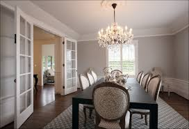 dining rooms crystal chandelier gray stained wall long dining