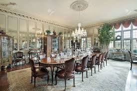 formal dining room in traditional home with wall mirrors stock