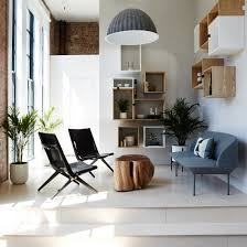 felt lined booths and scandinavian furniture feature in office for