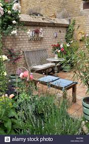 terrace of a backyard garden with seating area design jutta