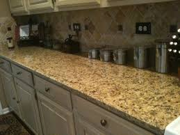 Backsplash Ideas With White Cabinets by Granite New Venetian Gold White Cabinets Stainless Steel Gas Oven
