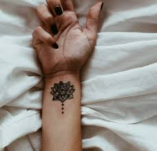 inner arm tattoos female lotus tattoo on the right inner wrist tatoos pinterest