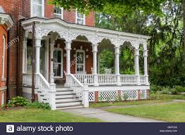 the front porch of a victorian home in milford pennsylvania