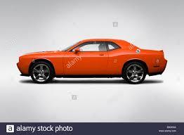 Dodge Challenger Orange - 2009 dodge challenger r t in orange drivers side profile stock