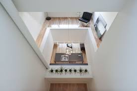 11 spectacular narrow houses and their ingenious design solutions narrow shaft house from atelier rzlbd airy design