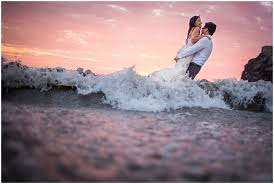 beach trash the dress at sunset maik dobiey wedding photography