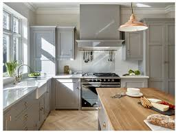 kitchen cabinets extension stainless steel appliances grey floors
