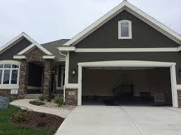 dark grey stucco exterior white trim nice stone entrance maba