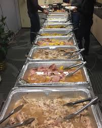 high touch technologies employees enjoy thanksgiving meal together