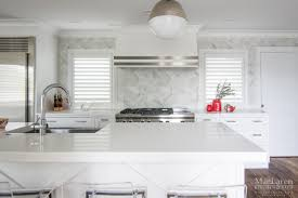 cambria quartz countertops in white cliff complimented by a